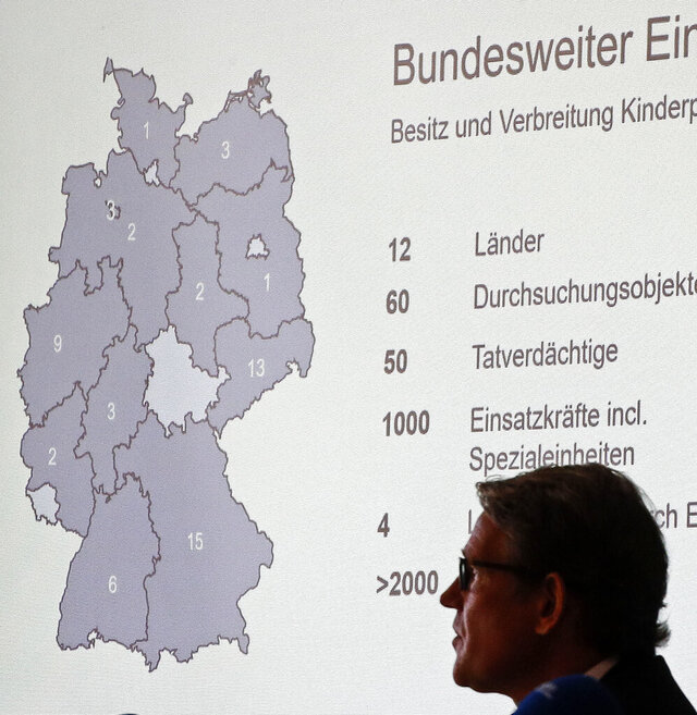 A map of Germany shows the number of raid places at a press conference at the police department in Cologne, Germany, about nationwide child pornography raids, Wednesday, Sept. 2, 2020. Special police units, coordinated by the Cologne Prosecutor's Office, have raided 60 places across Germany yesterday, linked to an ongoing investigation that started last year in the city of Bergisch Gladbach. (AP Photo/Martin Meissner)