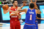 Denver Nuggets guard Facundo Campazzo, left, looks to pass the ball as New York Knicks forward Obi Toppin, front right, and guard Derrick Rose defend in the first half of an NBA basketball game Wednesday, May 5, 2021, in Denver. (AP Photo/David Zalubowski)