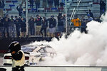 Chase Briscoe does a burnout as he celebrates winning the NASCAR Xfinity Series auto race Friday, Sept. 18, 2020, in Bristol, Tenn. (AP Photo/Steve Helber)