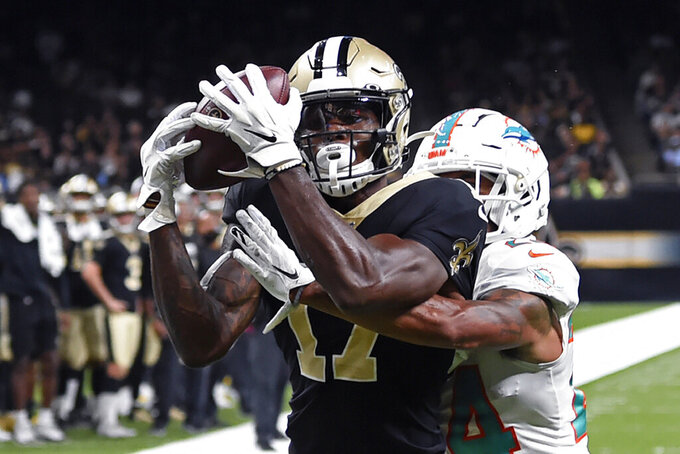 New Orleans Saints wide receiver Emmanuel Butler (17) pulls in a touchdown pass in front of Miami Dolphins cornerback Torry McTyer in the first half of an NFL preseason football game in New Orleans, Thursday, Aug. 29, 2019. (AP Photo/Bill Feig)