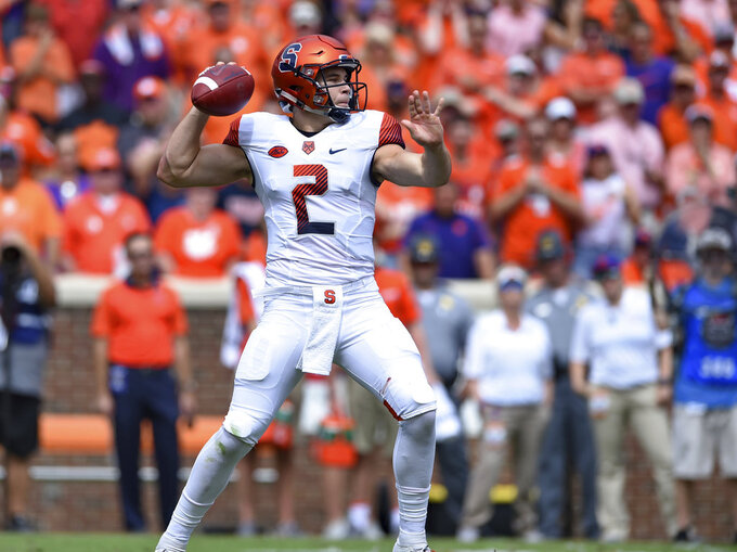 Syaracuse quarterback Eric Dungey drops back to pass during the first half of an NCAA college football game against Clemson Saturday, Sept. 29, 2018, in Clemson, S.C. Clemson won 27-23. (AP Photo/Richard Shiro)