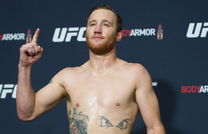 FILE - In this Sept. 13, 2019, file photo, lightweight fighter Justin Gaethje poses at a UFC Fight Night Vancouver official weigh-in in Richmond, British Columbia. UFC 249 scheduled for May 9 at Jacksonville Arena will be headlined by lightweight title contenders Tony Ferguson and Justin Gaethje. (Jonathan Hayward/The Canadian Press via AP, File)