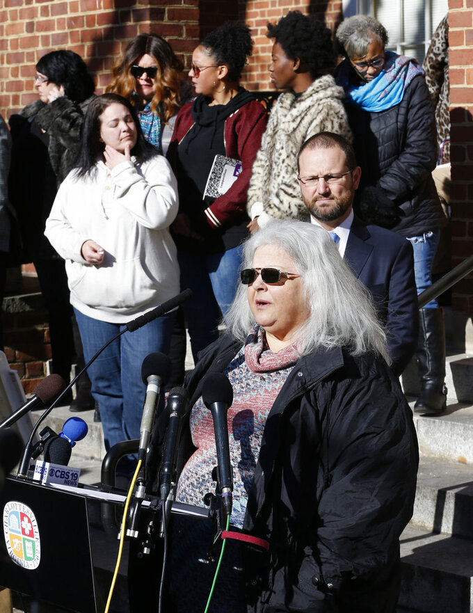 Susan Bro, front, mother of Heather Heyer, talks to the media in front of Charlottesville Circuit Court after a jury recommended life plus 419 years for James Alex Fields Jr. for the death of Heyer as well as several other charges related to the Unite the Right rally in 2017 in Charlottesville, Va., Tuesday, Dec. 11, 2018. Other victims of Fields attack are in the background. (AP Photo/Steve Helber)