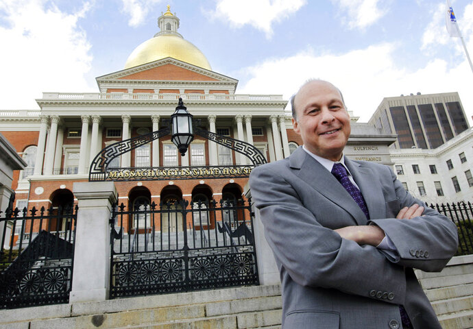 """FILE - In this April 2, 2012, file photo, Massachusetts state Sen. Stan Rosenberg, D-Amherst, poses outside the Statehouse in Boston. The Boston Globe reported Sunday, Feb. 4, 2018 that Rosenberg's husband, Bryon Hefner, had involved himself in matters before the Senate and had access to Rosenberg's Senate email despite Rosenberg's promise to keep a """"firewall"""" between his professional and personal lives. Massachusetts Gov. Charlie Baker says if there's truth to new reports involving Rosenberg then he shouldn't return to the Senate's top post. (AP Photo/Elise Amendola, File)"""