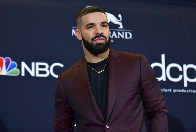 """FILE - This May 1, 2019 file photo shows Drake at the Billboard Music Awards in Las Vegas.  Drake is the leading nominee at the 2020 BET Awards, which will celebrate its 20th anniversary later this month. BET announced Monday that Drake is nominated for six honors, including video of the year and best male hip-hop artist. For both best collaboration and the viewer's choice award, Drake is nominated twice thanks to the hits """"No Guidance"""" with Chris Brown and """"Life Is Good"""" with Future. (Photo by Richard Shotwell/Invision/AP, File)"""