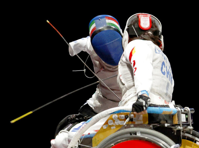 Italy's Beatrice Maria Vio, left, competes against China's Zhou Jingjing during their the wheelchair fencing women's foil Individual category B gold medal match in Chiba, near Tokyo, at the Tokyo 2020 Paralympic Games, Saturday, Aug. 28, 2021, in Tokyo, Japan. (Kyodo News via AP)