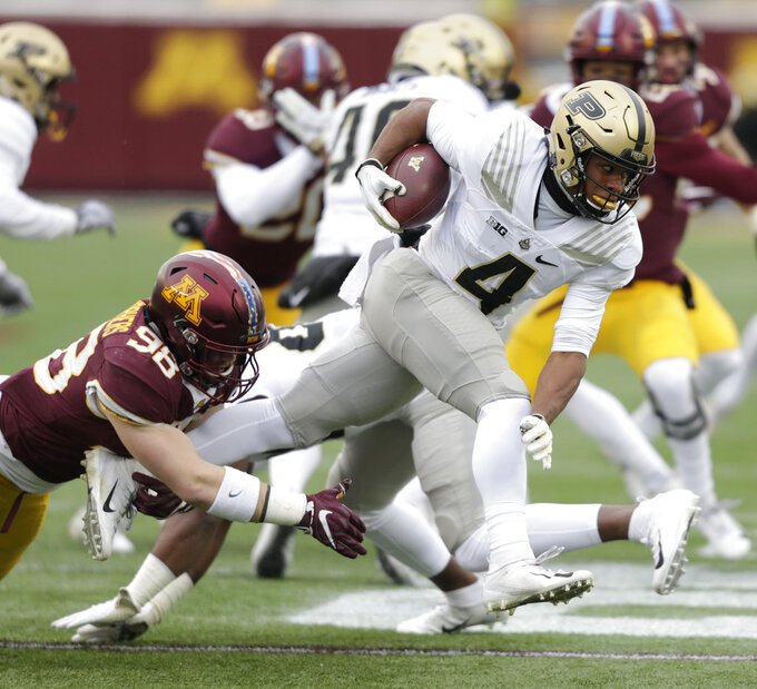 Purdue wide receiver Mondale Moore (4) returns a punt and is tackled by Minnesota tight end Max Janes (98) in the first quarter against Minnesota in a NCAA college football game Saturday, Nov. 10, 2018, in Minneapolis. (AP Photo/Andy Clayton-King)