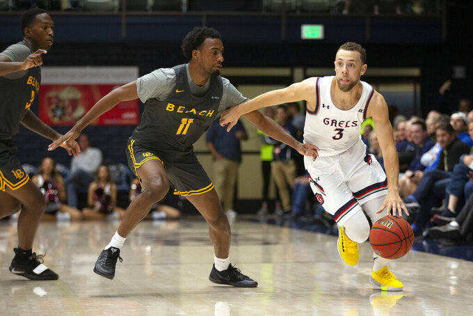 Saint Mary's guard Jordan Ford (3) drives past Long Beach State guard Jordan Griffin (11) during the second half of an NCAA college basketball game Thursday, Nov. 14, 2019, in Moraga, Calif. Saint Mary's won 81-63. (AP Photo/D. Ross Cameron)