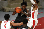 Tulane forward Kevin Cross (5) looks to pass as Houston forward Reggie Chaney, right, and Justin Gorham (4) defend during the first half of an NCAA college basketball game, Saturday, Jan. 9, 2021, in Houston. (AP Photo/Eric Christian Smith)