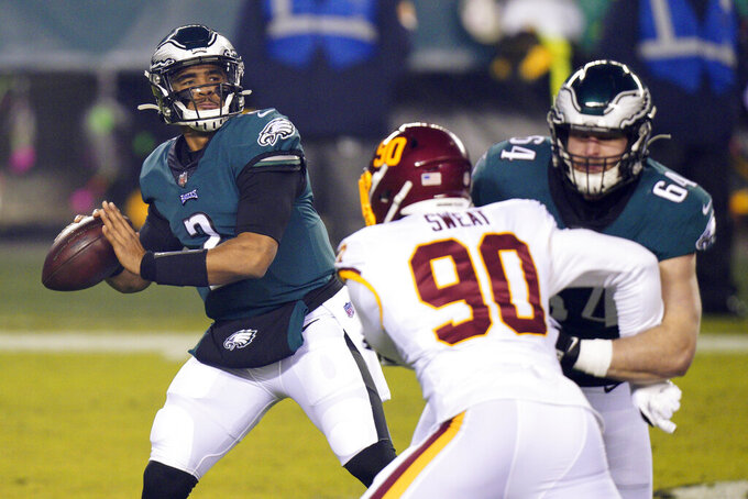 Philadelphia Eagles' Jalen Hurts plays during the first half of an NFL football game against the Washington Football Team, Sunday, Jan. 3, 2021, in Philadelphia. (AP Photo/Chris Szagola)
