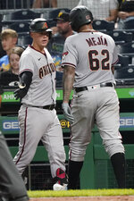 Arizona Diamondbacks' Humberto Mejia (62) is greeted by Carson Kelly after scoring on a hit by Ketel Martels in the fifth inning of a baseball game against the Pittsburgh Pirates, Monday, Aug. 23, 2021, in Pittsburgh. (AP Photo/Keith Srakocic)
