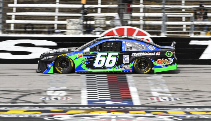 Driver Timmy Hill races down the front stretch during practice for a NASCAR Cup auto race at Texas Motor Speedway, Saturday, March 30, 2019, in Fort Worth, Texas. (AP Photo/Larry Papke)