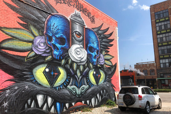 This Wednesday, Sept. 11, 2019 photo shows a mural painted Jeff Soto and Maxx Gramajo in Detroit. Mercedes-Benz USA is asking a judge to protect it from legal action over its use of images of the murals in social media posts. The company says four artists threatened to file a lawsuit after their works appeared last year in Instagram posts about the G 500 Series truck. (AP Photo/Ed White)