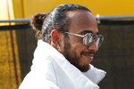 Mercedes driver Lewis Hamilton of Britain arrives at the Monza racetrack, in Monza, Italy, Thursday, Sept. 9, 2021. The Italian Formula One Grand Prix will be held on Sunday. (AP Photo/Luca Bruno)