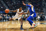 Connecticut's Christian Vital (1) dribbles as Tulsa's Elijah Joiner, right, defends in the first half of an NCAA college basketball game, Sunday, Jan. 26, 2020, in Hartford, Conn. (AP Photo/Jessica Hill)