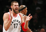 Toronto Raptors center Jonas Valanciunas (17) reacts toward the Raptors' bench after earning a free-throw during the second half of an NBA basketball game against the Brooklyn Nets, Tuesday, March 13, 2018, in New York. The Raptors defeated the Nets 116-102. (AP Photo/Kathy Willens)