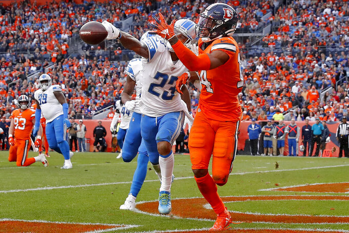 Detroit Lions cornerback Darius Slay (23) knocks away a pass in the end zone intended for Denver Broncos wide receiver Courtland Sutton (14) during the second half of an NFL football game, Sunday, Dec. 22, 2019, in Denver. (AP Photo/David Zalubowski)