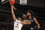Saint Louis forward Hasahn French, right, blocks a shot by Virginia Tech guard Nickeil Alexander-Walker during the first half of a first-round game in the NCAA men's college basketball tournament Friday, March 22, 2019, in San Jose, Calif. (AP Photo/Jeff Chiu)