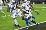 Indianapolis Colts cornerback Kenny Moore II (23) celebrates after making an interception against the Las Vegas Raiders during the first half of an NFL football game, Sunday, Dec. 13, 2020, in Las Vegas. (AP Photo/David Becker)
