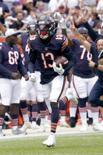 Chicago Bears wide receiver Rodney Adams heads to the end zone after catching a touchdown pass from quarterback Andy Dalton during the first half of an NFL preseason football game against the Buffalo Bills Saturday, Aug. 21, 2021, in Chicago. (AP Photo/David Banks)