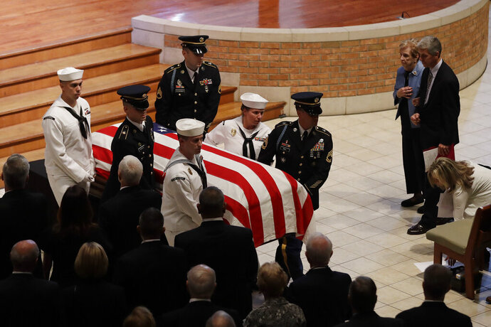 A military honor guard escorts the casket of Sen. Richard Lugar following a funeral service, Wednesday, May 15, 2019, in Indianapolis. Lugar was a longtime Republican senator and former Indianapolis mayor who's been hailed as an