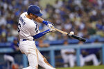Los Angeles Dodgers' Trea Turner breaks his bat as he singles during the third inning of a baseball game against the Colorado Rockies, Saturday, Aug. 28, 2021, in Los Angeles. (AP Photo/Marcio Jose Sanchez)