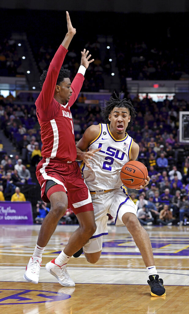 LSU forward Trendon Watford (2) drives to the basket around Alabama guard Herbert Jones (1) in the first half of an NCAA college basketball game, Wednesday, Jan. 29, 2020, in Baton Rouge, La. LSU won 90-76. (AP Photo/Bill Feig)