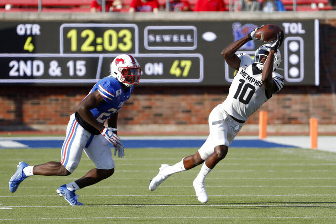 Memphis wide receiver Damonte Coxie (10) makes a reception in front SMU defensive back Brandon Stephens (23) during the second half of an NCAA college football game in Dallas, Saturday, Oct. 3, 2020. (AP Photo/Roger Steinman)