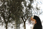 Pope Francis and Bartolomew I, Patriarch of Constantinopolis, walk by olive trees during an inter-religious ceremony for peace in the square outside Rome's City Hall, Tuesday, Oct. 20, 2020 (AP Photo/Gregorio Borgia)