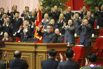 In this photo provided by the North Korean government, North Korean leader Kim Jong Un, center, acknowledges to the applauds after he made his closing remarks at a ruling party congress in Pyongyang, North Korea Tuesday, Jan. 12, 2021. Kim vowed all-out efforts to bolster his country's nuclear deterrent during the major ruling party meeting where he earlier laid out plans to work toward salvaging the broken economy. Independent journalists were not given access to cover the event depicted in this image distributed by the North Korean government. The content of this image is as provided and cannot be independently verified. Korean language watermark on image as provided by source reads: