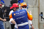 Race driver Scott Dixon, of New Zealand, hugs car owner Chip Ganassi after winning the IndyCar auto race at Indianapolis Motor Speedway in Indianapolis, Saturday, July 4, 2020. (AP Photo/Darron Cummings)