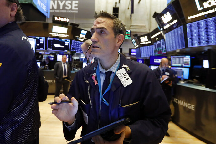 FILE - In this Jan. 10, 2020, file photo trader Gregory Rowe works on the floor of the New York Stock Exchange. The U.S. stock market opens at 9:30 a.m. EST on Friday, Jan. 17 (AP Photo/Richard Drew, File)