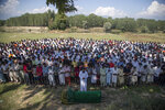 Kashmiris offer funeral prayers near the coffin of slain policeman Ishfaq Ayoub during his funeral on the outskirts of Srinagar, Indian controlled Kashmir, Friday, Aug. 14, 2020. Ayoub was one of the two police officers killed by anti-India rebels in Indian-controlled Kashmir Friday. (AP Photo/Mukhtar Khan)