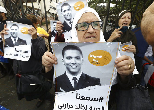 People gather in a show of support for Khaled Drareni,outside the court house Tuesday, Sept.8, 2020 in Algiers. Drareni was imprisoned Aug. 10 for