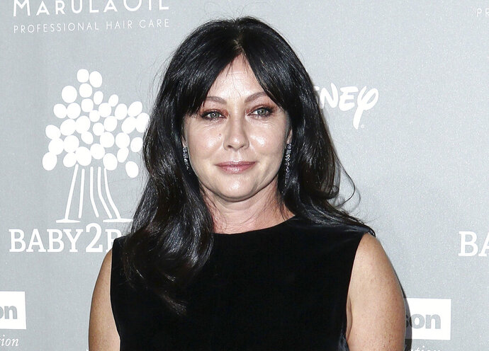 """FILE - In this Nov. 14, 2015 file photo, Shannen Doherty attends the 4th Annual Baby2Baby Gala in Culver City, Calif. Doherty is battling a recurrence of breast cancer that has progressed to stage four, telling fans """"it's a bitter pill to swallow."""" Doherty, 48, has been working on a reboot of"""