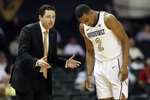 Vanderbilt head coach Bryce Drew, left, talks with guard Joe Toye (2) in the second half of an NCAA college basketball game against UNC Asheville, Monday, Dec. 31, 2018, in Nashville, Tenn. (AP Photo/Mark Humphrey)