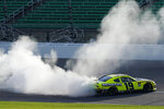 Brandon Jones does a burnout after winning a NASCAR Xfinity Series auto race at Kansas Speedway in Kansas City, Kan., Saturday, July 25, 2020. (AP Photo/Charlie Riedel)