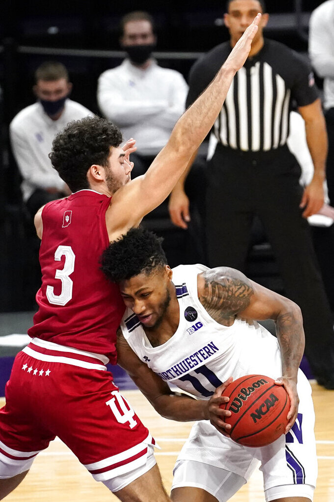 Indiana guard Anthony Leal, left, guards Northwestern guard Anthony Gaines during the second half of an NCAA college basketball game in Evanston, Ill., Wednesday, Feb. 10, 2021. Indiana won 79-76 in double- overtime. (AP Photo/Nam Y. Huh)