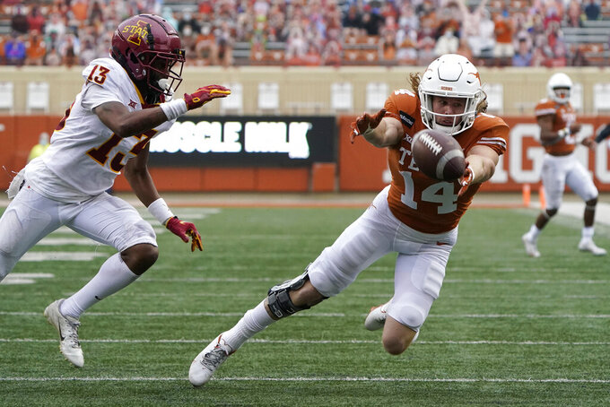 Texas wide receiver Brenden Schooler (14) fails to make a catch as Iowa State defensive back Tayvonn Kyle (13) closes in on the play during the first half of an NCAA college football game, Friday, Nov. 27, 2020, in Austin, Texas. (AP Photo/Eric Gay)