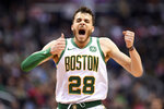 Boston Celtics guard RJ Hunter (28) reacts after he made a 3-point basket during the second half of the team's NBA basketball game against the Washington Wizards, Tuesday, April 9, 2019, in Washington. The Celtics won 116-110. (AP Photo/Nick Wass)