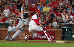 Miami Marlins' Jorge Alfaro, left, scores past St. Louis Cardinals catcher Matt Wieters during the eighth inning of a baseball game Wednesday, June 19, 2019, in St. Louis. (AP Photo/L.G. Patterson)