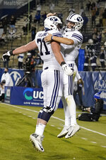 BYU quarterback Zach Wilson, right, celebrates with offensive lineman Blake Freeland after scoring against Western Kentucky during the first half of an NCAA college football game Saturday, Oct. 31, 2020, in Provo, Utah. (AP Photo/Rick Bowmer, Pool)