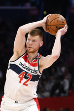 FILE - In this March 6, 2020, file photo, Washington Wizards forward Davis Bertans (42) looks to pass next against the Atlanta Hawks during the second half of an NBA basketball game, in Washington.  Wizards forward Davis Bertans will skip the Orlando-based resumption of the NBA season. He is the first known example of a healthy, eligible player sitting out. Bertans' decision was first reported Monday, June 22, 2020, by ESPN and confirmed to The Associated Press by a person familiar with his plans, speaking on condition of anonymity because neither the player nor team had made an announcement. (AP Photo/Nick Wass)