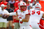 Miami of Ohio quarterback Brett Gabbert (5) passes in the first half of an NCAA college football game against Cincinnati, Saturday, Sept. 14, 2019, in Cincinnati. (AP Photo/John Minchillo)