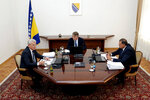 Members of Bosnia's tripartite presidency, Muslim member Sefik Dzaferovic, left, Croat member Zeljko Komsic and Bosnian Serb member Milorad Dodik, right, speak during a meeting in Sarajevo, Bosnia, Tuesday, Aug. 20, 2019. A meeting Tuesday between Bosnia's Muslim, Serb and Croat leaders ended without an agreement on forming the new cabinet because the Bosnian Serb member of the presidency, Milorad Dodik, was against a package that would also include adopting an action plan that would move Bosnia closer to NATO membership. (Harun Muminovic/FENA via AP)