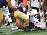 Washington running back Myles Gaskin (9) is stopped by Auburn defensive lineman Derrick Brown (5) after in the first half of an NCAA college football game Saturday, Sept. 1, 2018, in Atlanta. (AP Photo/John Bazemore)