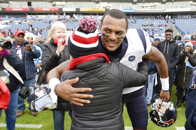 Houston Texans quarterback Deshaun Watson greets fans before an NFL football game between the Texans and the Tennessee Titans Sunday, Dec. 15, 2019, in Nashville, Tenn. (AP Photo/Mark Zaleski)