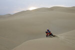Sam Sunderland, of United Kingdom, rides his KTM motorbike during the third stage of the 2018 Dakar Rally between Pisco and San Juan de Marcona, Peru, Monday, Jan. 8, 2018. (AP Photo/Ricardo Mazalan)