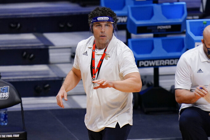 Georgia Tech head coach Josh Pastner watches as his team plays Loyola Chicago in the first half of a college basketball game in the first round of the NCAA tournament at Hinkle Fieldhouse, Indianapolis, Friday, March 19, 2021. (AP Photo/AJ Mast)
