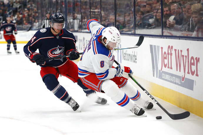New York Rangers' Jacob Trouba, right, skates away from Columbus Blue Jackets' Gustav Nyquist, of Sweden, during the second period of an NHL hockey game Friday, Feb. 14, 2020, in Columbus, Ohio. (AP Photo/Jay LaPrete)